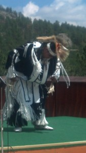 A Native American dancer at Crazy Horse tells a story through the Crow Hope dance